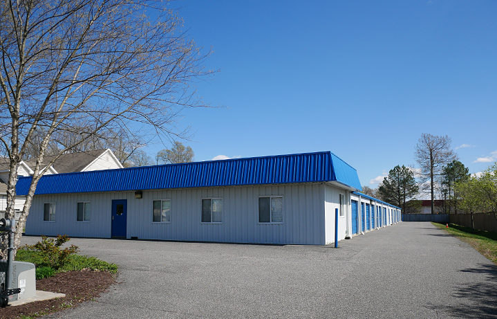 Self-storage with a paved lot.